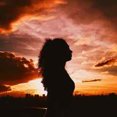 silhouette of woman during golden hour